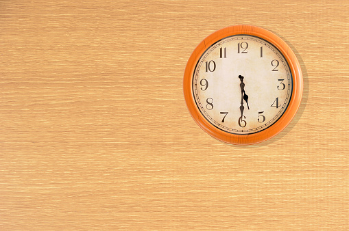 Clock Showing 530 Oclock On A Wooden Wall Stock Photo - Download Image Now
