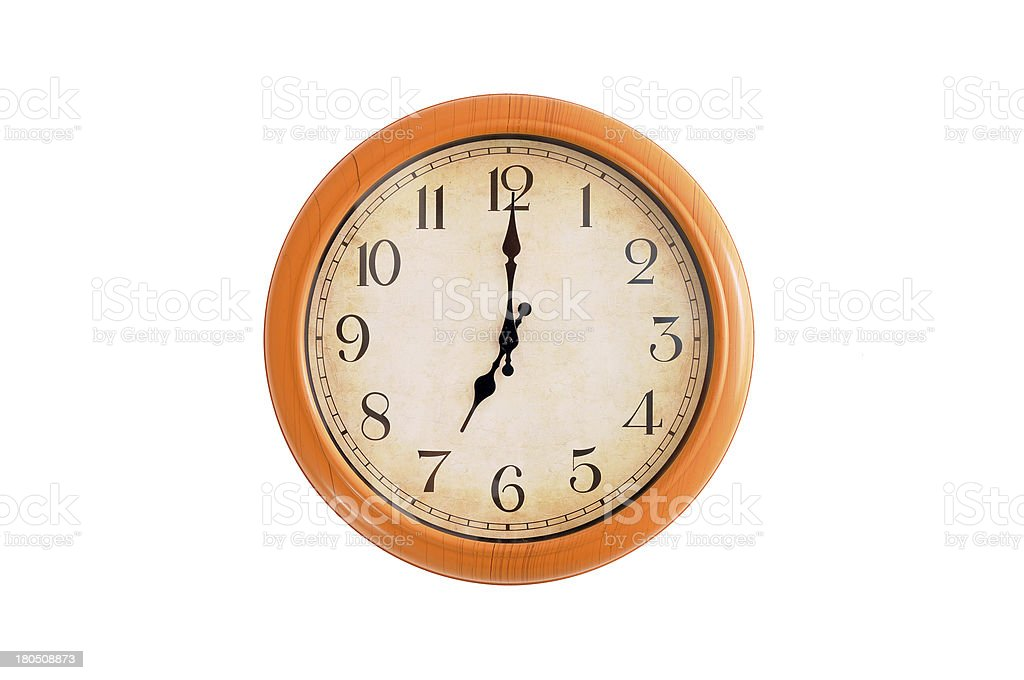 Clock showing 7 o'clock on a white wall royalty-free stock photo