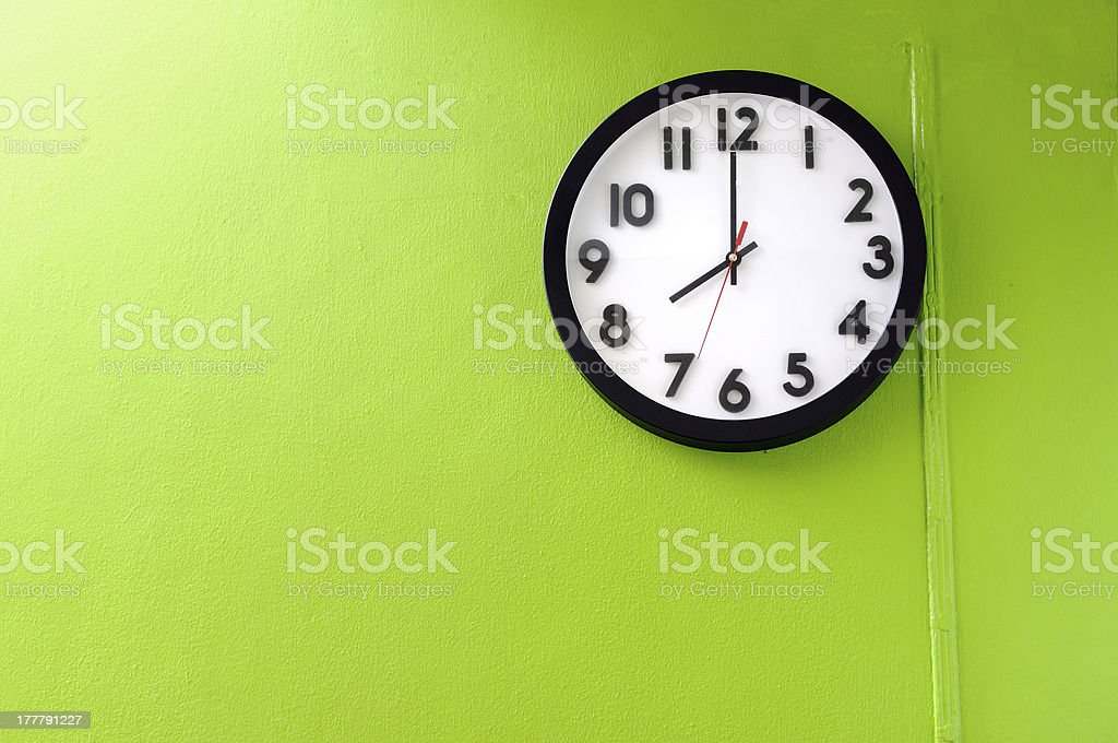 Clock showing 8 o'clock stock photo