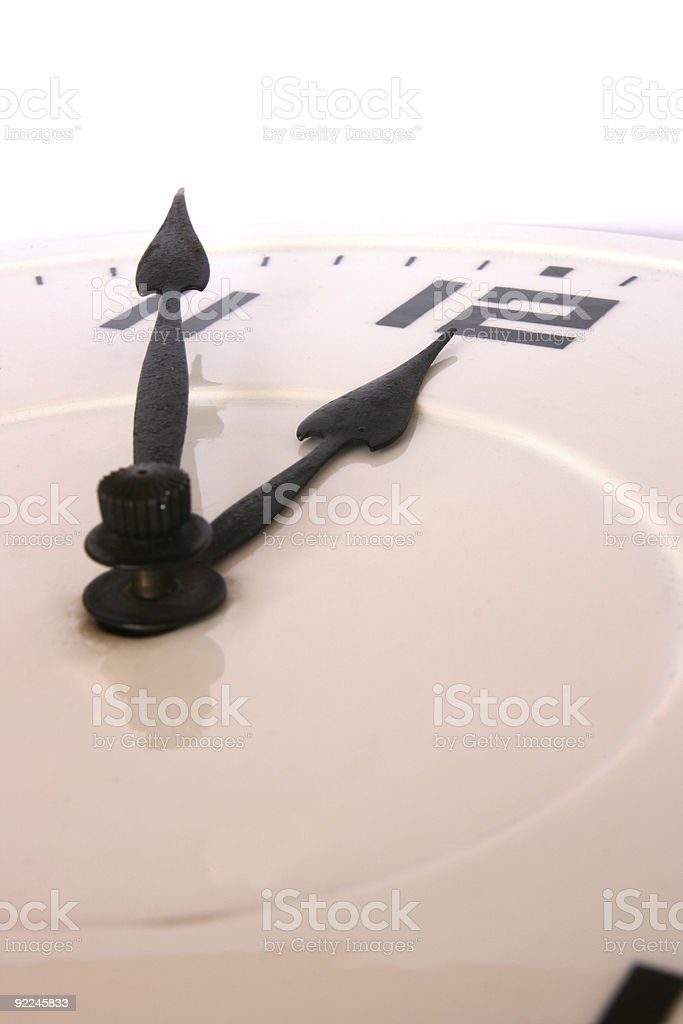 Clock showing five minutes to twelve stock photo