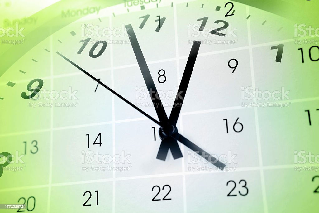 A clock superimposed on a calendar, showing aspects of time stock photo