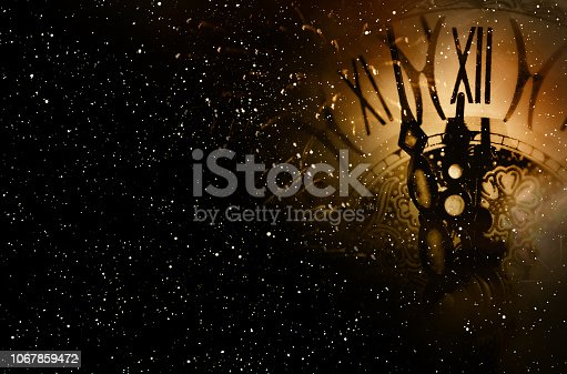 Clock time at the midnight sky for a new years eve background