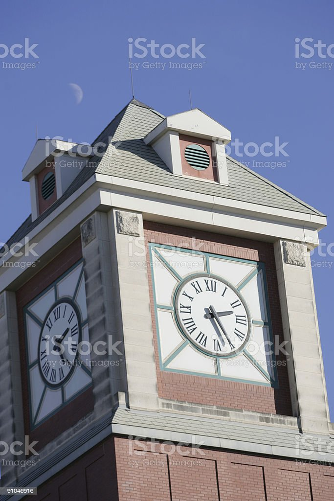 Clock tower and moon royalty-free stock photo