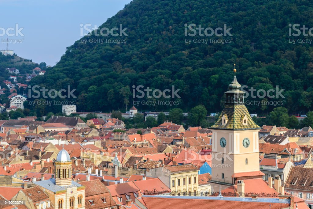 Clock tower and roof tiles in Brasov, Transylvania, Romania stock photo
