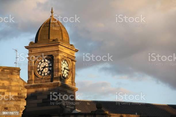 Clock Tower Basking I Solnedgången-foton och fler bilder på Arkitektur