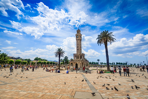 Izmir Konak square with Historical Clock Tower-Saat Kulesi . It was built in 1901, in order to commemorate the 25th anniversary of Abdulhamid II accession to the throne. The tower is 25 metres high and has 4 fountains around the circular base. It is a the symbol of Izmir City.
