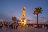 Izmir, Turkey - January 31, 2016: Izmir Clock Tower (built in 1901) is a historic clock tower located at the Konak Square in Konak district of Izmir, Turkey. Konak square is an attraction point of local turkish people of Izmir.