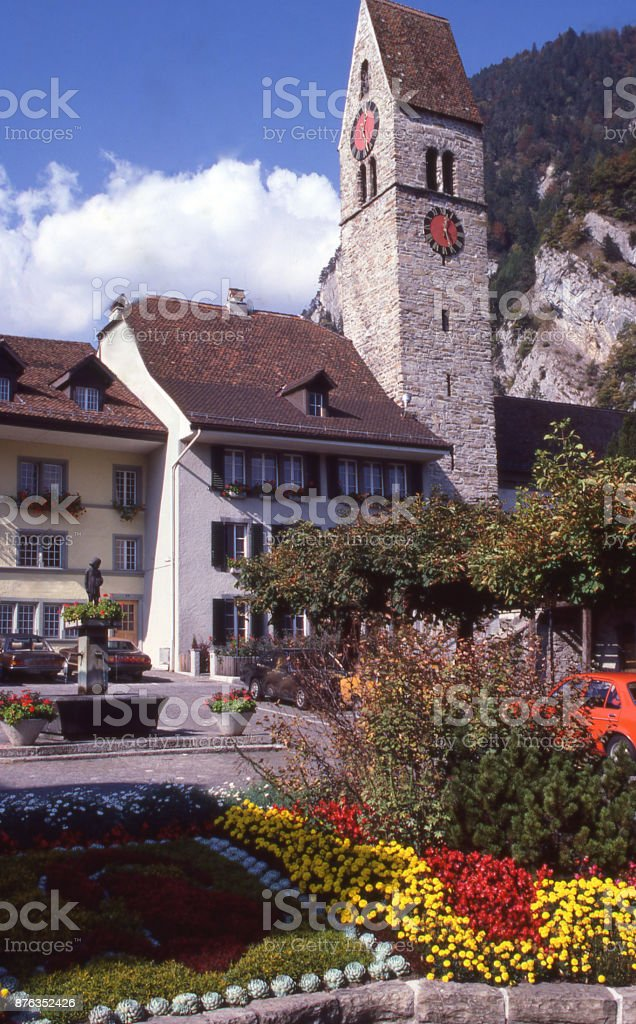 Clock tower of city hall and flower gardens in Interlaken near Brienz on Brienzersee Switzerland Europe stock photo