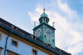 Clock tower of Styrian Armoury, or Landeszeughaus on Herrengasse Street in Downtown and Old city of Graz in Austria, in Styria in Europe. Blue sky on the background
