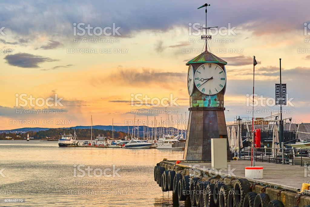 Clock tower on Aker Brygge Dock at the waterfront with marina on background stock photo