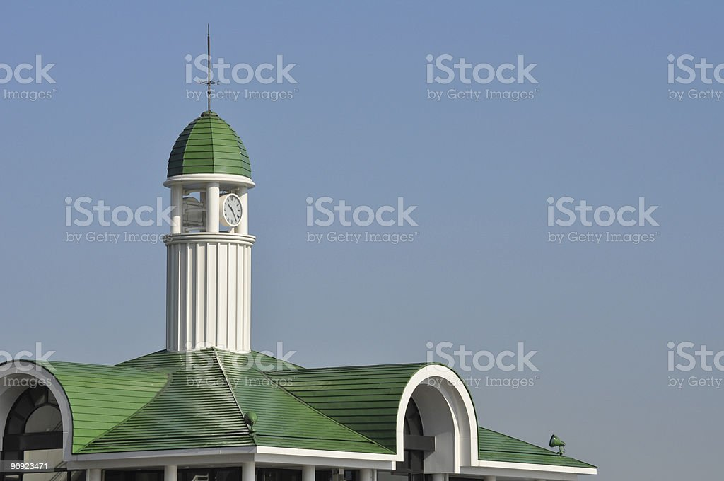 Clock tower on green roof royalty-free stock photo