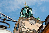 Clock tower on historical church Storkyrkan of Gamla Stan, Old Town in Sockholm, Sweden