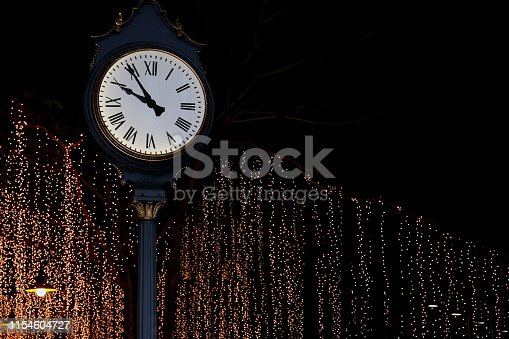 clock tower on street park night with bokeh lighting gold yellow background romantic nightlife