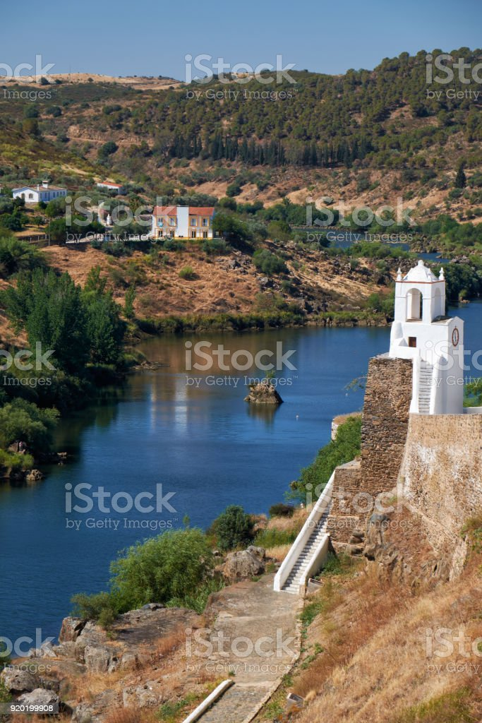 Clock tower (Torre do Relogio) on the right bank of Guadiana. Mertola. Portugal stock photo