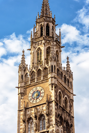 Clock Tower or Glockenspiel of Rathaus (New Town Hall) on Marienplatz square, Munich, Bavaria, Germany. It is old landmark of Munich. Detail of ornate Gothic building with chime in Munich city center.