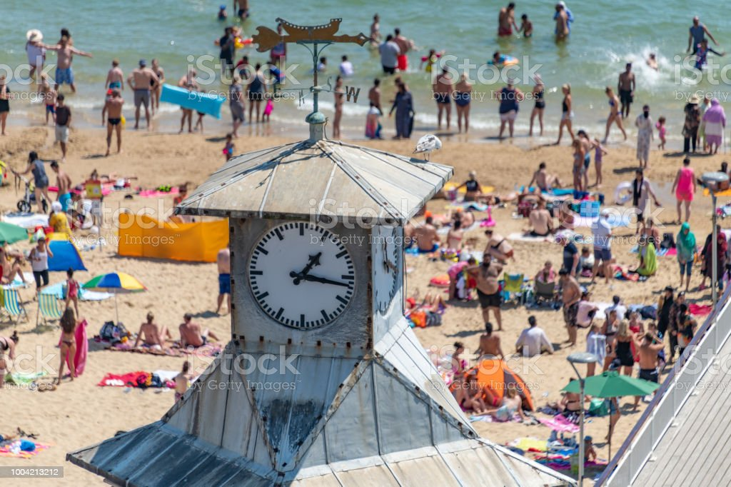 Clock tower over Bournemouth beach on a summers day stock photo