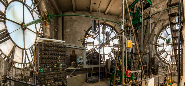 Clock tower works with gears and dials stock photo