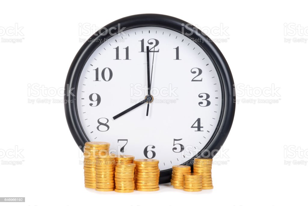clock with gold coins time is money concept stock photo
