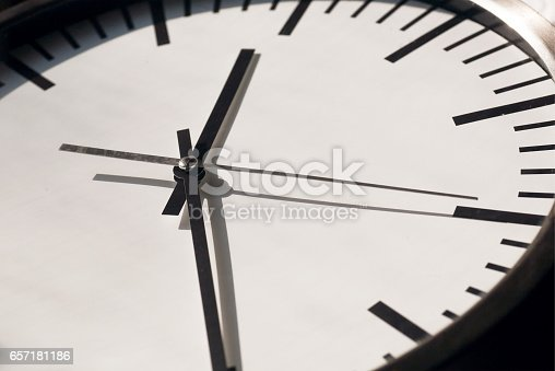 istock Clock with moving hands on white dial. Life time 657181186