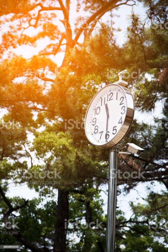Clock with solar cells and motion camera stock photo