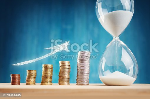 Clock with stacked coins. Pig with money savings and hourglass on blue background