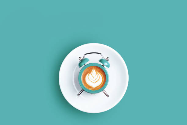 clock with the dial of coffee on turquoise background. - fare una pausa foto e immagini stock