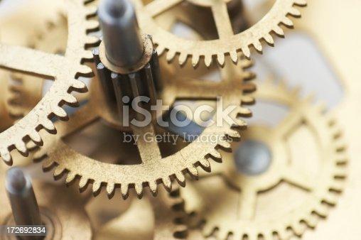 istock clockwork gears macro 172692834