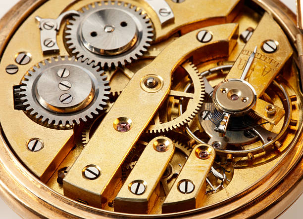 clockwork macro shot on white background - watch timepiece stock photos and pictures
