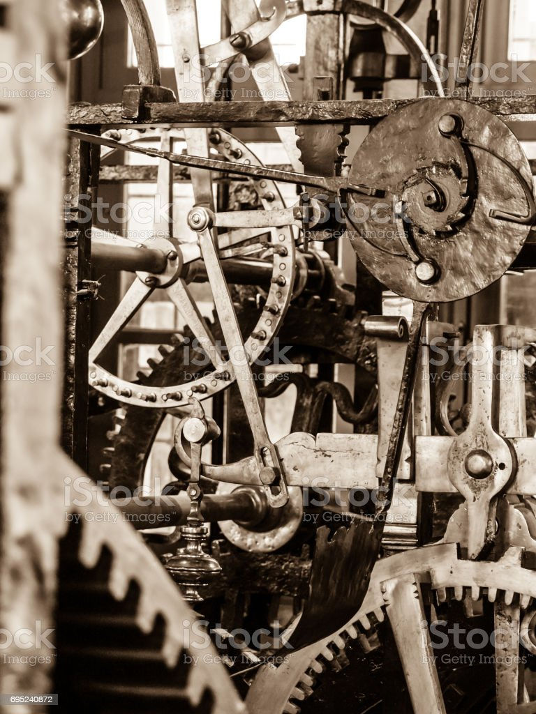 Clockwork mechanism. Close up view of cog wheels and other mechanical parts of vintage tower clock stock photo