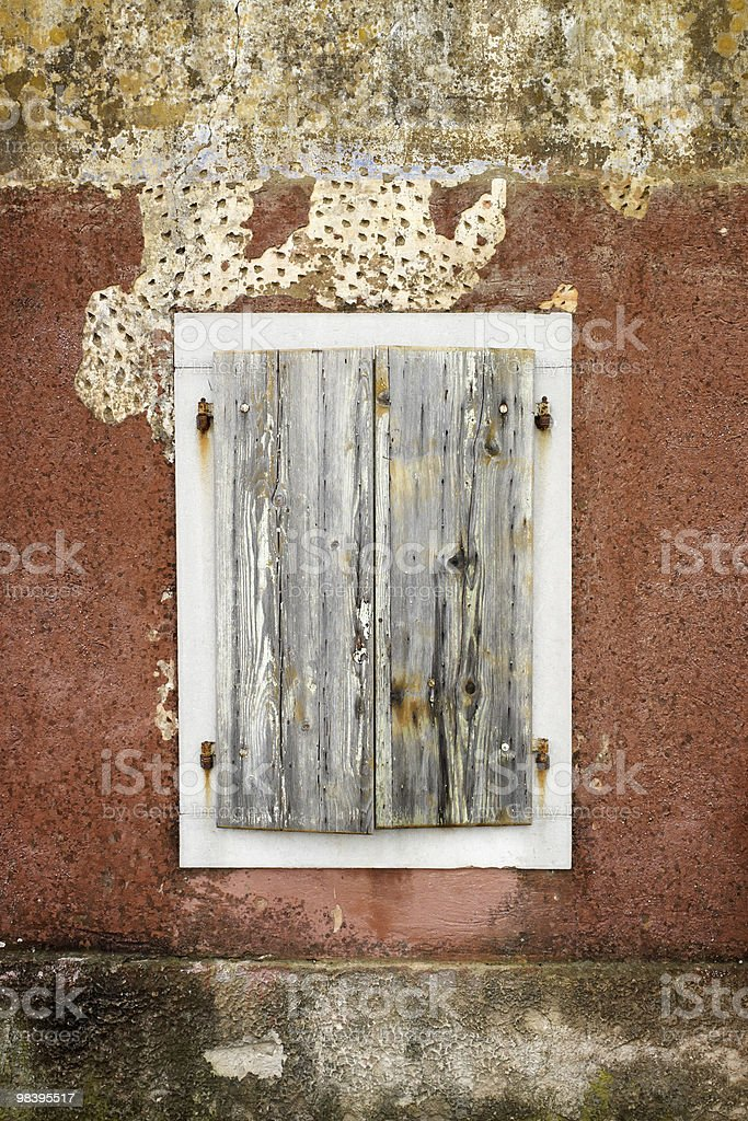 Cloesed wood window with white border royalty-free stock photo