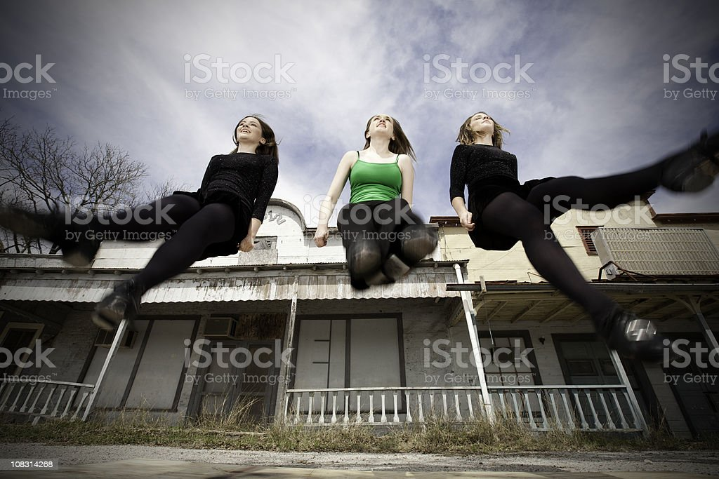 Clog Dancers Dancing in Mid-Air at Old Country Town stock photo