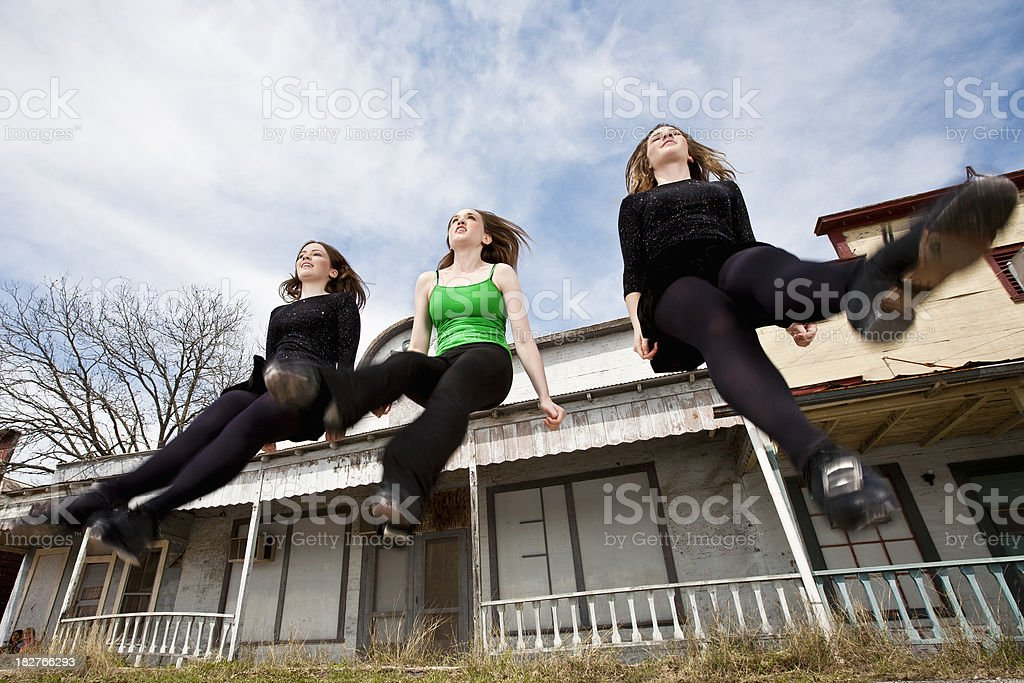 Clog Dancers Jumping in Mid-Air at Old Country Town stock photo