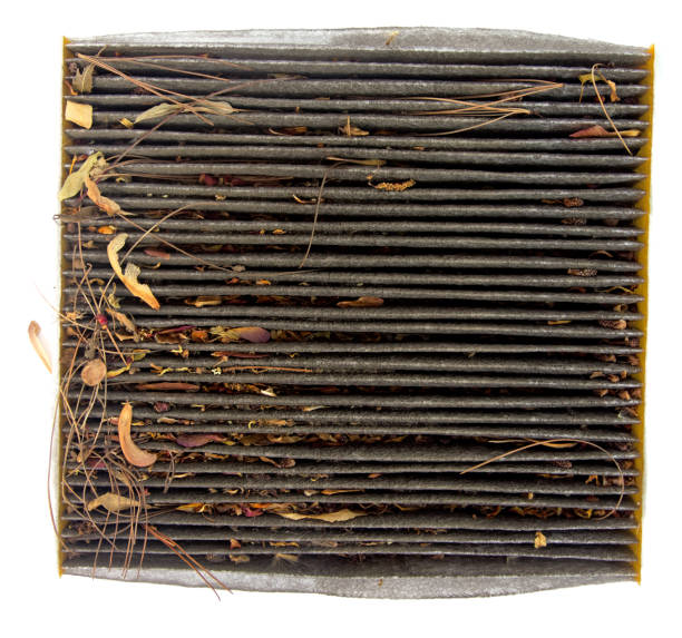 Clogged Automobile Cabin Air Filter Dirty automobile cabin air filter clogged with dirt, dust and organic debris. Isolated. passenger cabin stock pictures, royalty-free photos & images