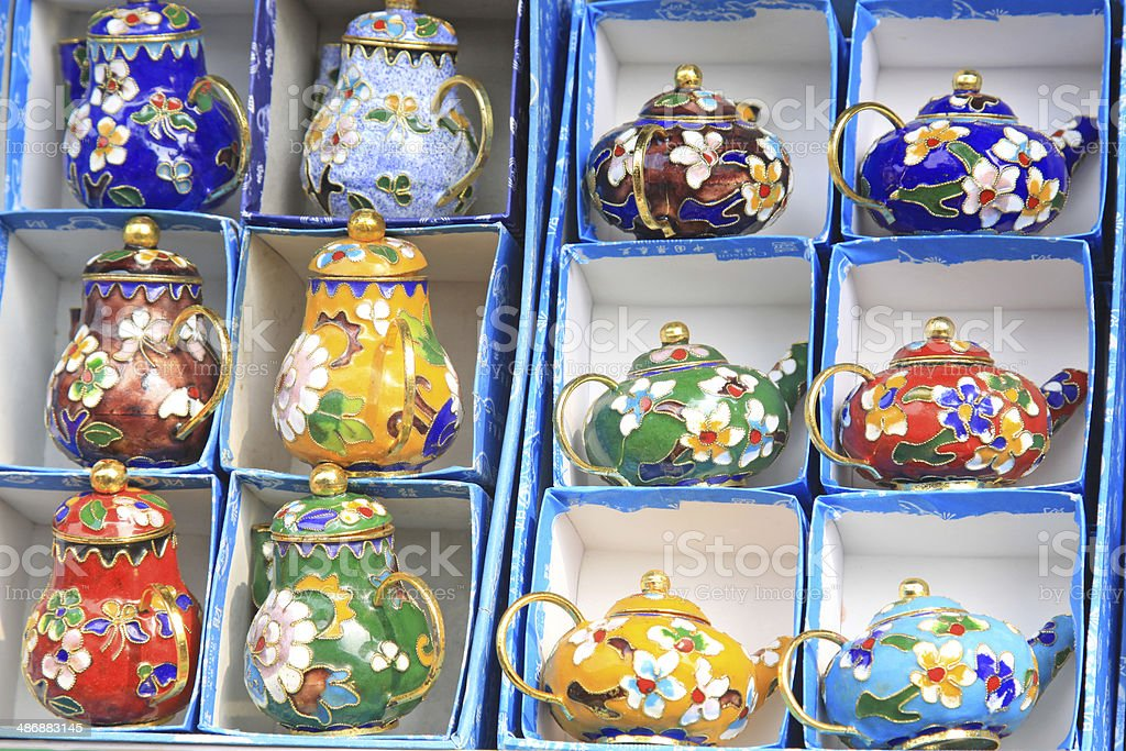Cloisonne teapot in the stall stock photo