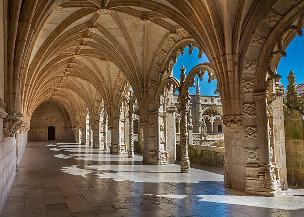 Cloister view in Jeronimos Monastery, Lisbon, Portugal Lisbon, Portugal - June 29, 2016: Cloister view in Jeronimos Monastery during summer 2016 abbey monastery stock pictures, royalty-free photos & images