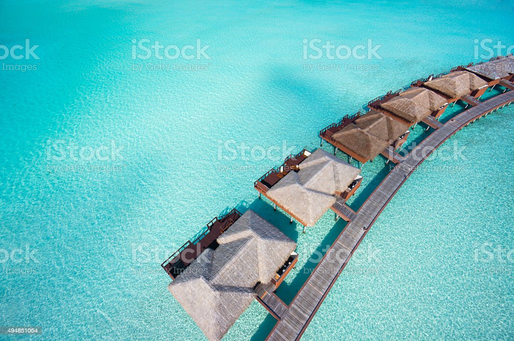 close aerial overtware bungalows in lagoon stock photo