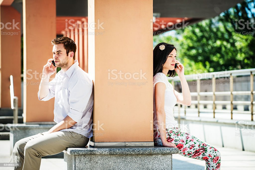 Close and distant - problems in relationship? stock photo