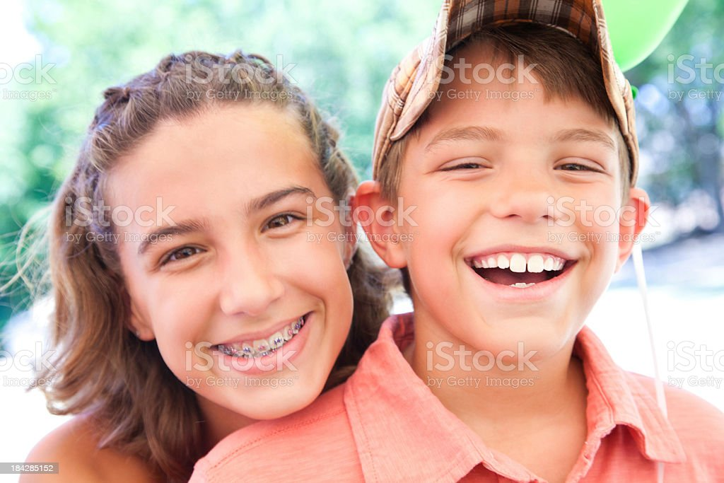 Close Brother and Sister Having Fun Together stock photo