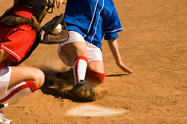 close call on home plate - softball stock photos and pictures