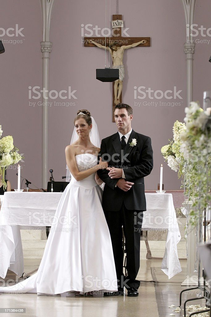 Close Couple Bride and Groom Inside Old Church Aisle Portrait royalty-free stock photo