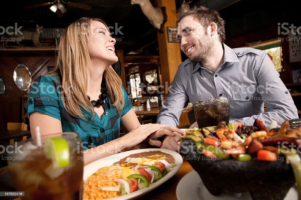 Close Couple Enjoying Dinner at a Mexican Food Restaurant royalty-free stock photo