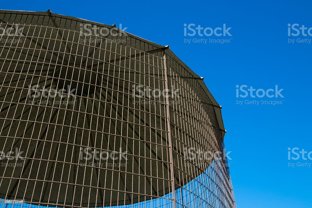 Close Crop of Farm Building Corn Dryer and Blue Sky. stock photo
