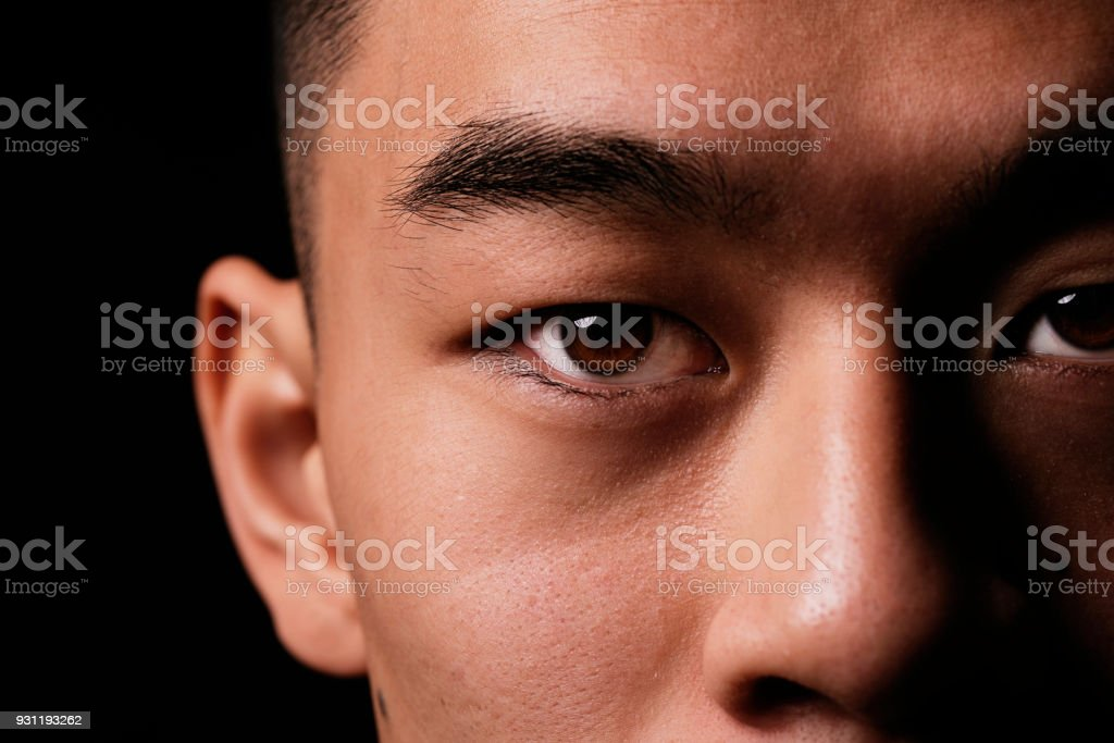 Close detail of the eye of asian man. stock photo