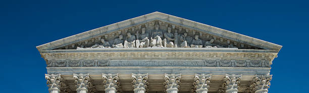 Close Detail top facade of the US Supreme Court stock photo