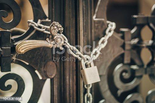 Door in chapel in the basilica in Krakow in Poland.  Padlock, chain. No people.