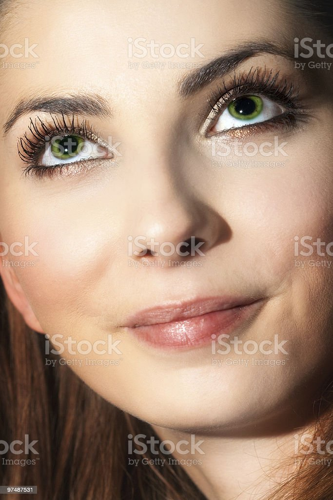 Close face of cute young woman looking up royalty-free stock photo