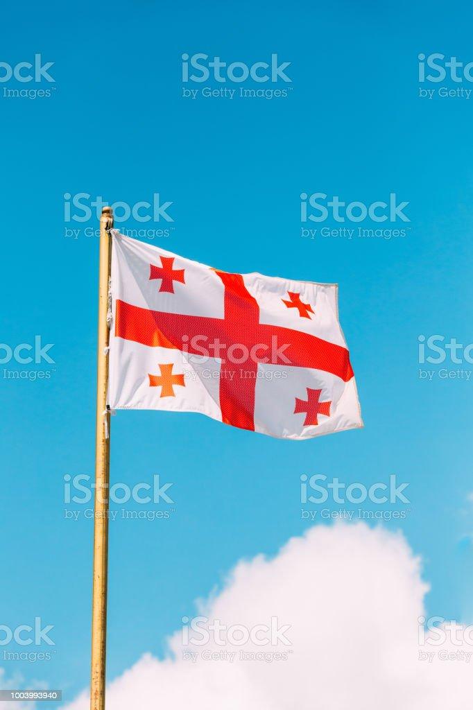 Close Flag Of Georgia Five Cross Flag Waving At Blue Sunny Sky