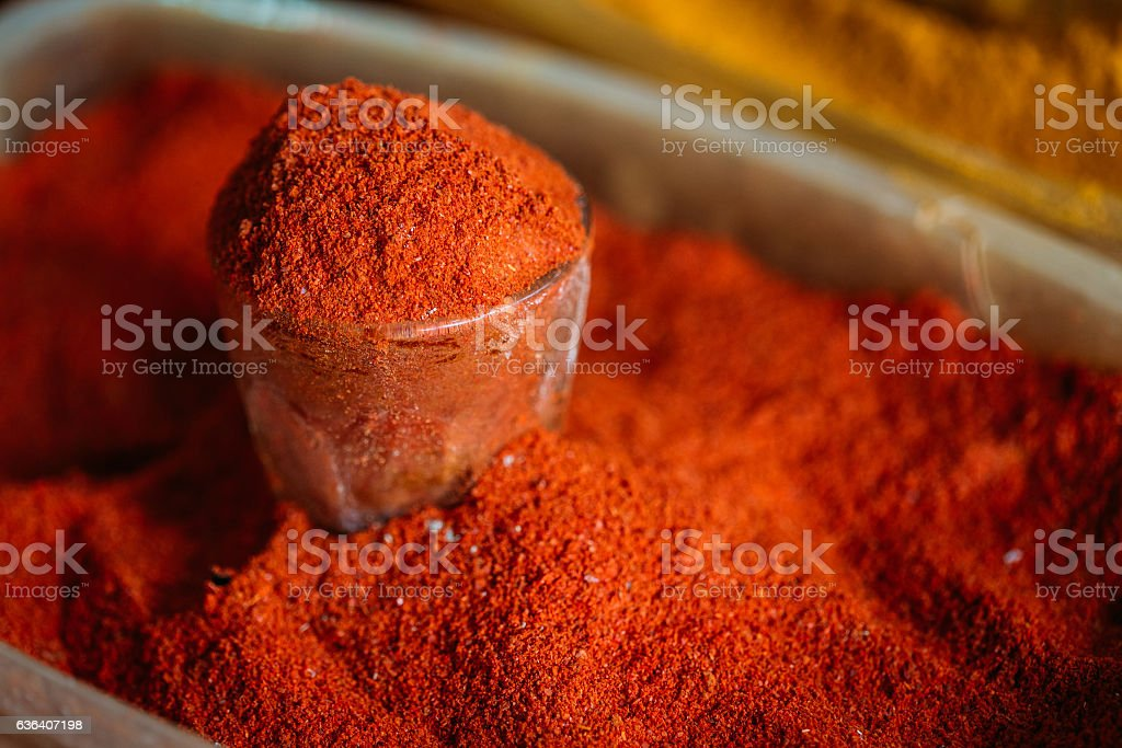 Close Glass With Powdered Paprika, Cayenne Pepper. Heap Of Bright stock photo