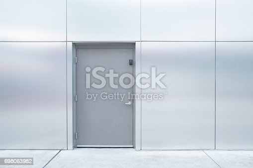 istock close grey door with aluminium or steel wall 698063982