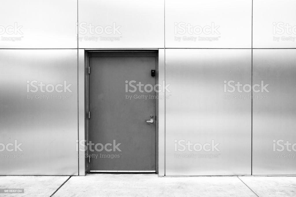 close grey door with aluminium or steel wall close grey door with aluminium or steel wall Abstract Stock Photo